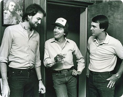Byron Hill, George Strait and Blake Mevis, pictured together in 1982 at the No.1 Party for 'Fool Hearted Memory' (written by Byron Hill and Alan R. Mevis) (note the photo of the iconic Gene Watson in the background) / Photo courtesy of The Country Music Foundation