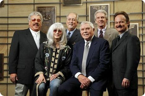 Emmylou Harris (second left) and Tom T. Hall (third right), pose with The Statler Brothers (standing from left, Harold Reid, Don Reid, Phil Balsley and Jimmy Fortune) after Country Music Association (CMA) announced their membership into The Country Music Hall of Fame, on Tuesday 12 February 2008, in Nashville (the late Ernest 'Pop' Stoneman was also inducted) / photo courtesy of Country Music Association (CMA)